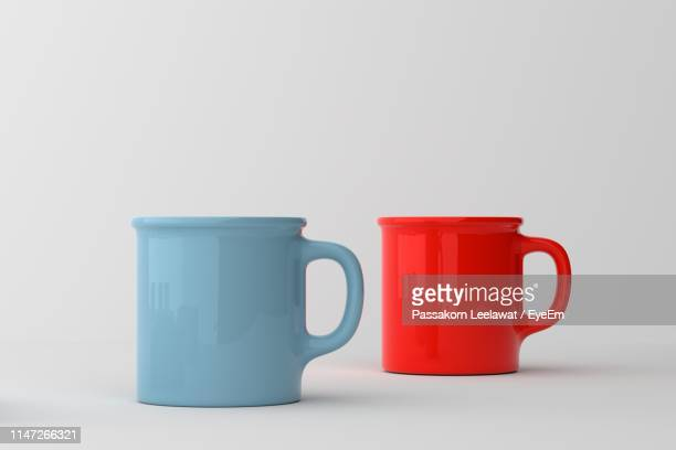 close-up of cups on white background - coffee cup stock pictures, royalty-free photos & images