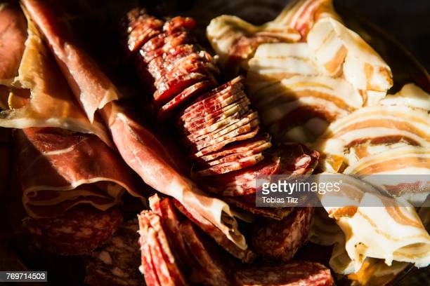 close-up of cured meats - salumeria stock photos and pictures