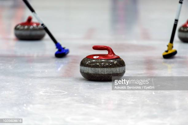 Close-Up Of Curling Stones On Ice Rink