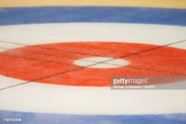 close-up of curling stones on ice rink - curling sport stock pictures, royalty-free photos & images