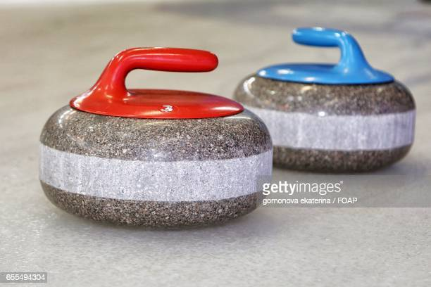Close-up of curling stones
