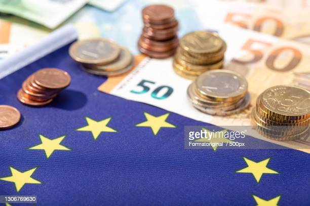 close-up of currency and currency on table - paycheck protection stock pictures, royalty-free photos & images