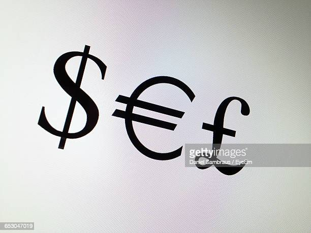 Close-Up Of Currency Symbols Against White Background