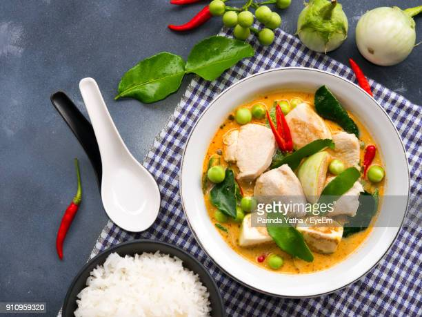 close-up of curry in bowl by rice on table - thai food stock pictures, royalty-free photos & images