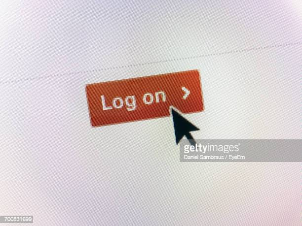close-up of curser on log on icon - log on stock photos and pictures