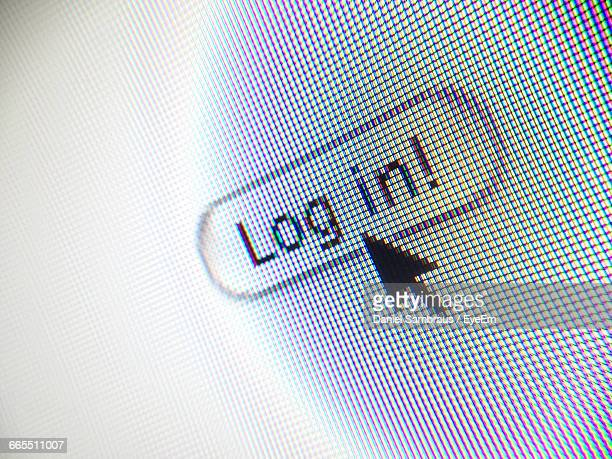 close-up of cursor at log in button computer monitor - log on stock photos and pictures