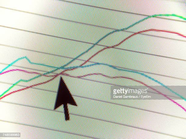 Close-Up Of Cursor On Line Graph