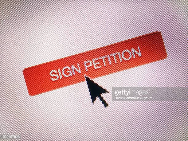 close-up of cursor on sign petition icon - petition stock photos and pictures