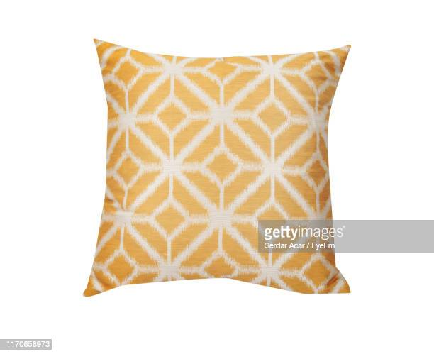 close-up of cushion against white background - cushion stock pictures, royalty-free photos & images