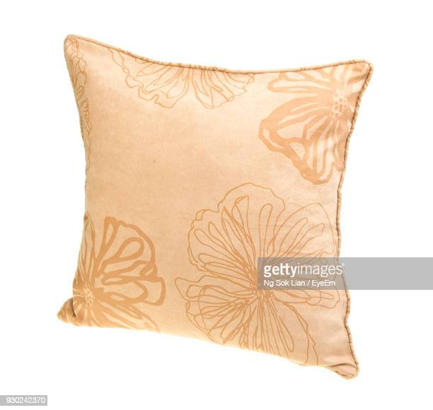 close-up of cushion against white background - cushion stock photos and pictures