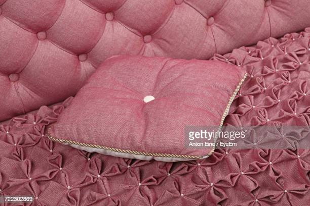 Close-Up Of Cushion On Pink Sofa