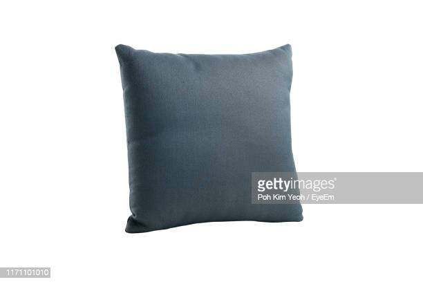 close-up of cushion over white background - cushion stock pictures, royalty-free photos & images