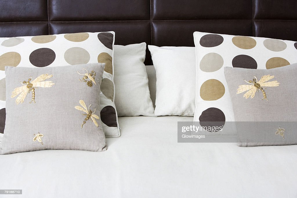 Close-up of cushions and pillows on the bed : Stock Photo