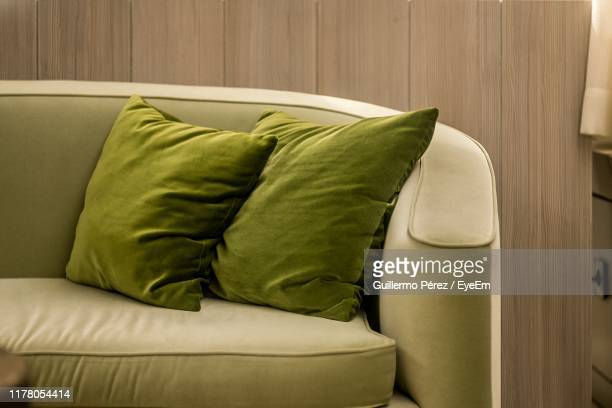 close-up of cushions on sofa at home - cushion stock pictures, royalty-free photos & images