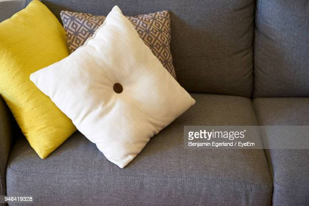 close-up of cushions on sofa at home - cushion stock photos and pictures