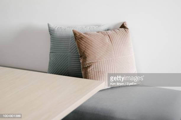 close-up of cushions on sofa - cushion stock pictures, royalty-free photos & images