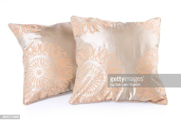 close-up of cushions over white background - cushion stock photos and pictures
