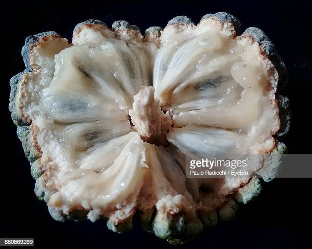 Close-Up Of Custard Apple On Black Background