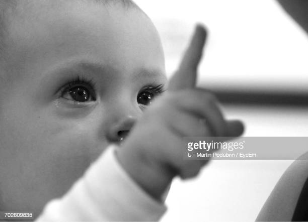 Close-Up Of Cute Baby Boy Pointing