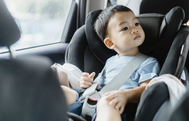 Close-Up Of Cute Baby Boy Sitting In Car