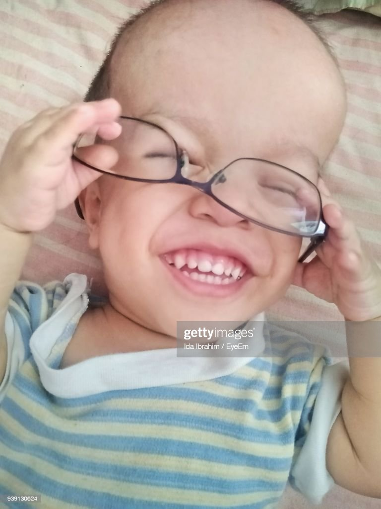 closeup of cute baby boy suffering from down syndrome holding