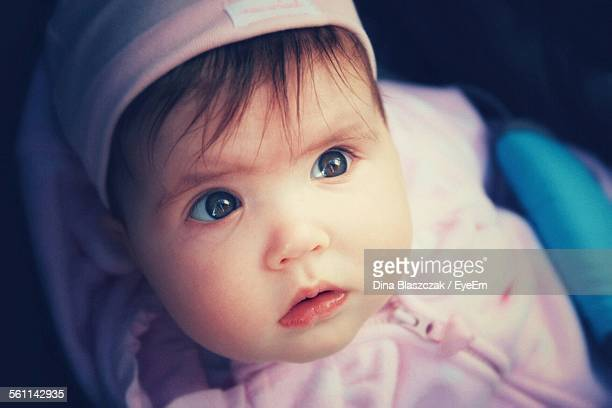 Close-Up Of Cute Baby Girl At Home