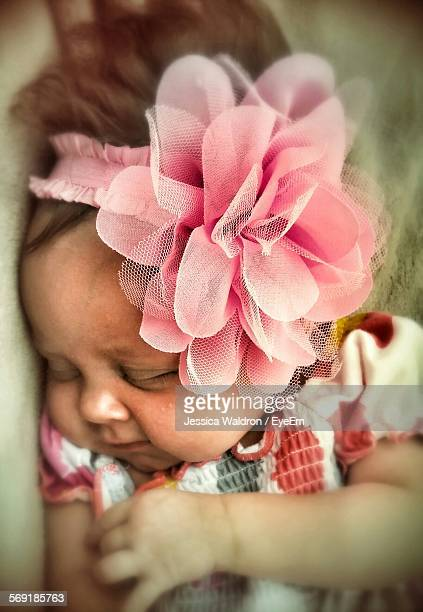 Close-up of cute baby girl sleeping