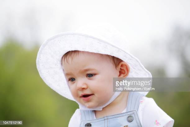 Close-Up Of Cute Baby Girl Wearing Hat