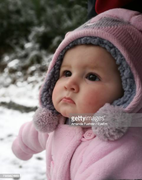 Close-Up Of Cute Baby Looking Away