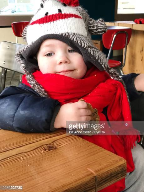 close-up of cute boy in warm clothing - brianne stock pictures, royalty-free photos & images