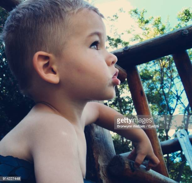 Close-Up Of Cute Boy Looking Away