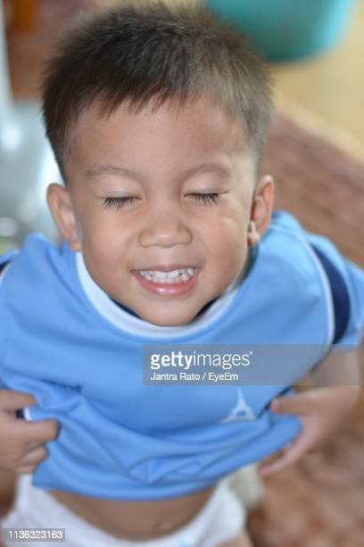 Close-Up Of Cute Boy With Eyes Closed