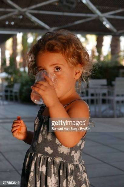 Close Up Of Cute Girl Drinking Water