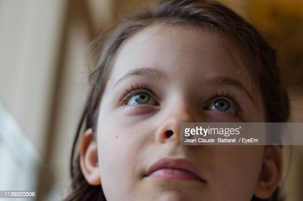 close-up of cute girl looking up - one girl only stock pictures, royalty-free photos & images
