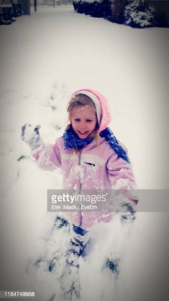 close-up of cute girl playing in snow - mack stock pictures, royalty-free photos & images