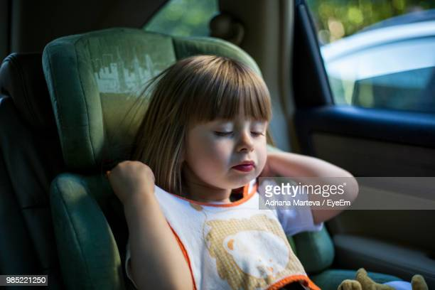 Close-Up Of Cute Girl Sitting In Car