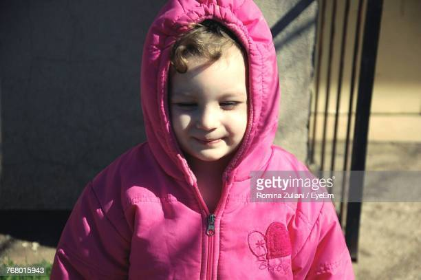 Close-Up Of Cute Girl Wearing Pink Hooded Shirt
