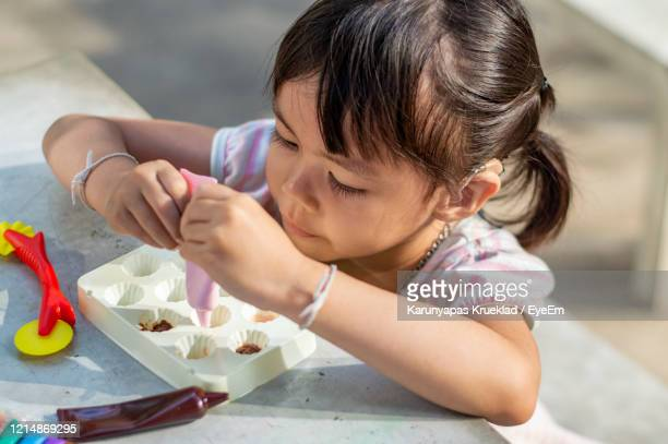 close-up of cute girl with clay - children only stock pictures, royalty-free photos & images