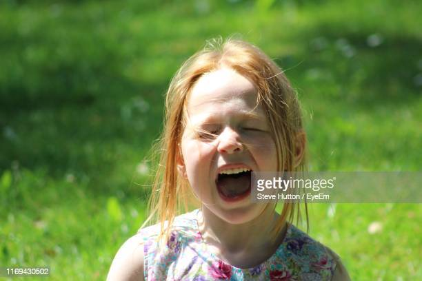 close-up of cute girl with mouth open - hutton stock photos and pictures