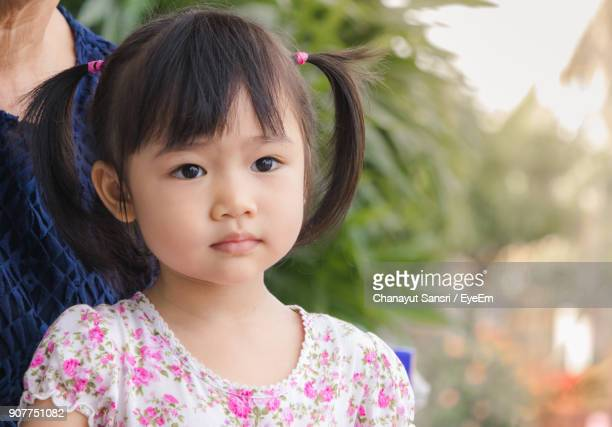 close-up of cute girl with parent - chanayut stock photos and pictures