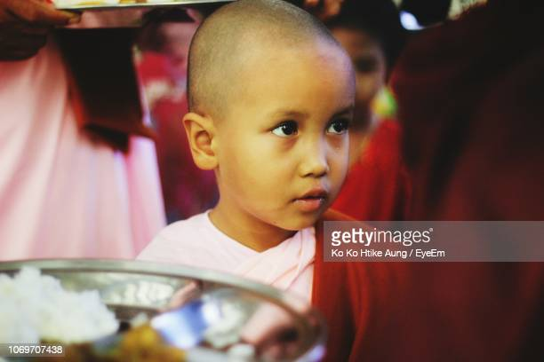 close-up of cute monk in temple - ko ko htike aung stock pictures, royalty-free photos & images