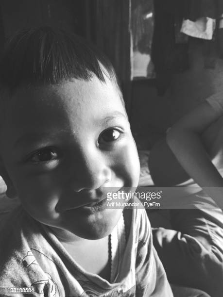 close-up of cute smiling boy at home - munandar stock pictures, royalty-free photos & images