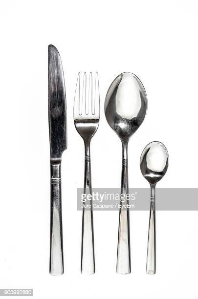 close-up of cutleries over white background - silverware stock pictures, royalty-free photos & images