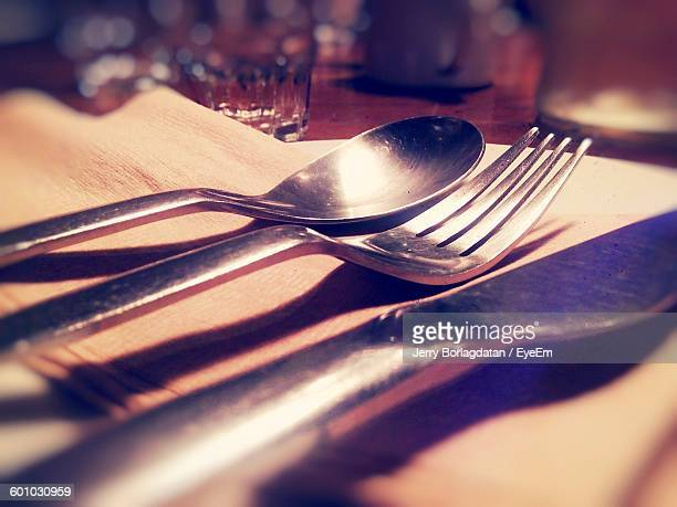 Close-Up Of Cutlery With Napkin On Table