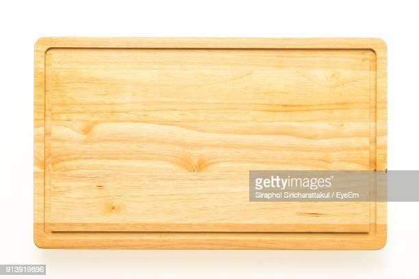 close-up of cutting board over white background - cutting board stock pictures, royalty-free photos & images