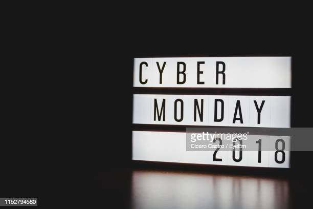 close-up of cyber monday 2018 text on information sign against black background - cyber monday stock pictures, royalty-free photos & images