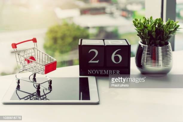 close-up of cyber monday sale on digital tablet with shopping cart. - cyber monday stock pictures, royalty-free photos & images