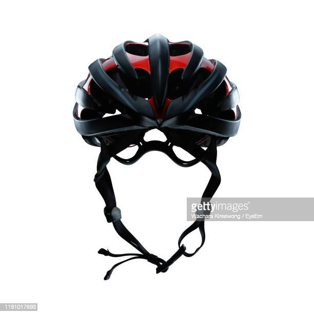 close-up of cycling helmet against white background - cycling helmet stock pictures, royalty-free photos & images