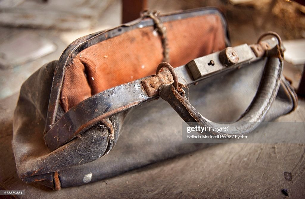 Close-Up Of Damaged Purse On Table : Stock Photo