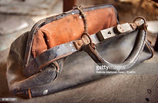 close-up of damaged purse on table - leather purse stock pictures, royalty-free photos & images